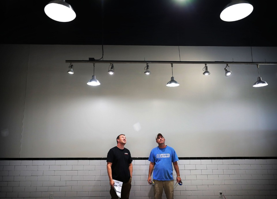 <strong>Owner Chris Tapp (left) consults with contractor Jason Brewer as work continues at Louie's Deli &amp; Meat Market in Arlington on Sept. 12. Tapp says he hopes his place will become a neighborhood spot for regulars, who he and his family will get to know by name. &ldquo;We want that face-to-face interaction with our customers.&rdquo;</strong>&nbsp;(Jim Weber/Daily Memphian)