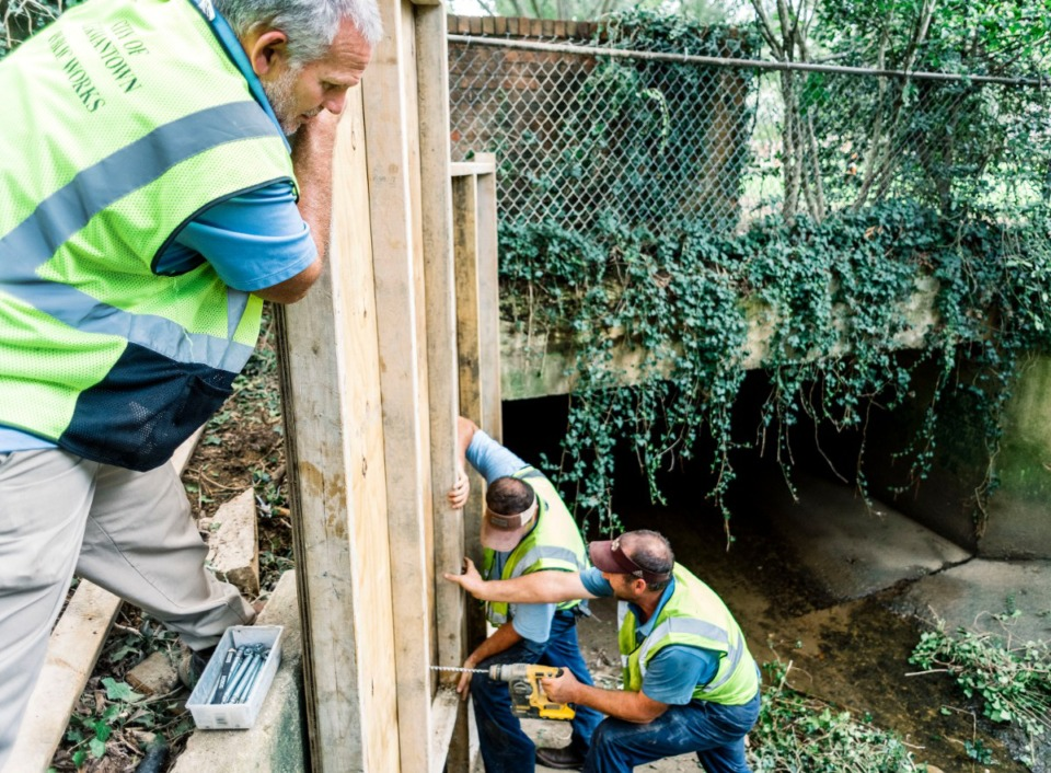 <strong>Barry Reeder (left), crew supervisor, braces an emergency wall to be installed by his crew in Germantown. The Germantowm Public Works Department was cleaning out ditches and making repairs in preparation for heavy rains the week of Aug. 26.</strong> (Houston Cofield/Special to the Daily Memphian)
