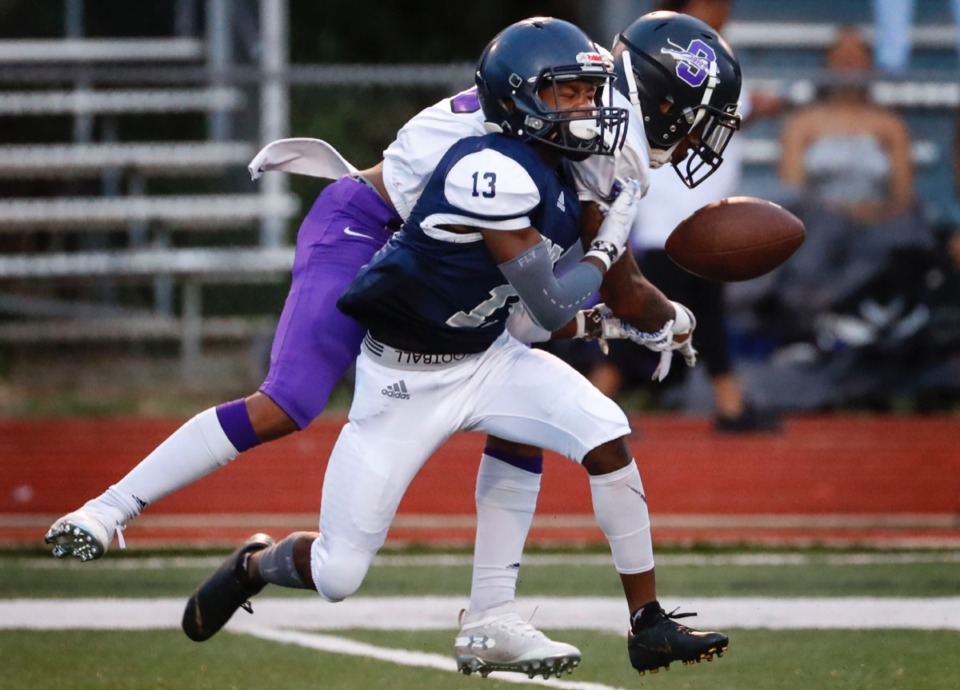 <strong>Kirby receiver Ledarion Carpenter (front) drops a pass while being harassed by Southwind's Kameron Collins Friday, Sept. 20.</strong> (Mark Weber/Daily Memphian)