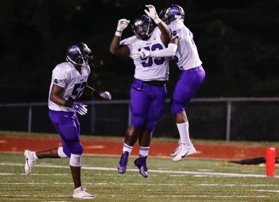 <strong>Southwind defensive lineman Tylandrius Gatewood (center) celebrates a touchdown after grabbing an interception against Kirby Friday, Sept. 20.</strong> (Mark Weber/Daily Memphian)