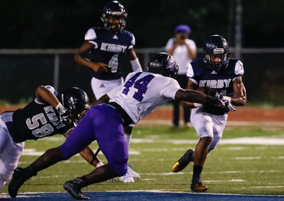 <strong>Kirby running back Charles Thomas (right) looks to get around Southwind defender Quintavis Wilkins (left) Friday, Sept. 20.</strong> (Mark Weber/Daily Memphian)