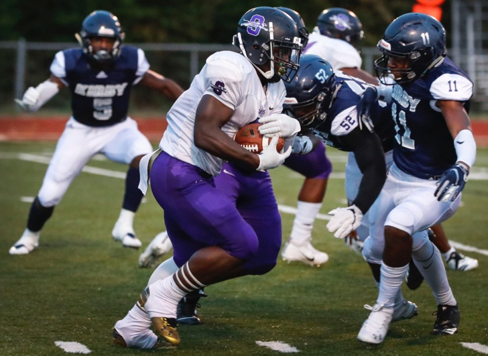 <strong>Southwind running back Romal Webb (with ball) looks for a lane against the Kirby defense Friday, Sept. 20.</strong> (Mark Weber/Daily Memphian)