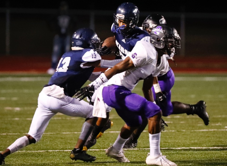 <strong>Kirby running back Charles Thomas (with ball) looks to get around the Southwind defense Friday, Sept. 20.</strong> (Mark Weber/Daily Memphian)