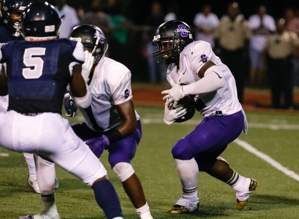 <strong>Southwind running back Romal Webb (with ball) looks for daylight in between Kirby defenders Friday, Sept. 20.</strong> (Mark Weber/Daily Memphian)