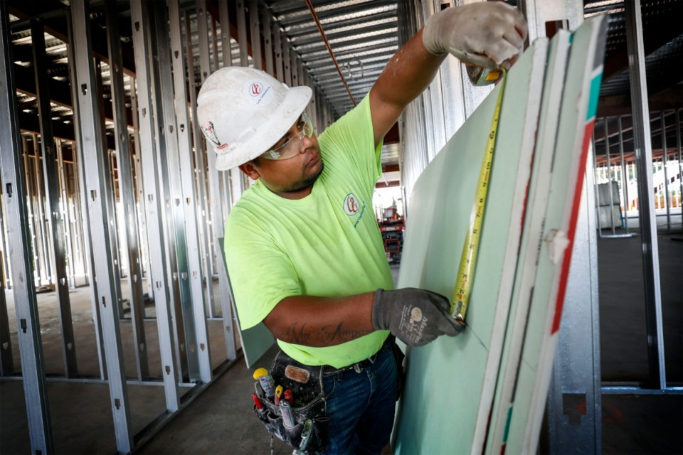 <strong>Construction worker Adrian Tinajero measures sheet rock during construction of the new $25 million Shelby County Health Department building on Sept. 16, 2019. The project is expected to be finished several months ahead of schedule.</strong> (Mark Weber/Daily Memphian)