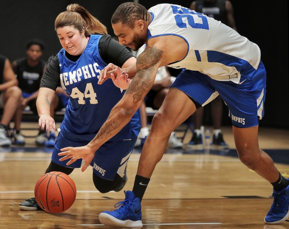 """<strong>Ashley Rush (left) scrambles toe-to-toe for a loose ball with former University of Memphis player Will Coleman during the&nbsp;<span class=""""s1"""">Penny Hardaway Basketball Fantasy Experience</span> at the Laurie-Walton Family&nbsp;<span class=""""s1"""">Basketball&nbsp;</span>Center on Sept. 21, 2019.</strong> (Jim Weber/Daily Memphian)"""