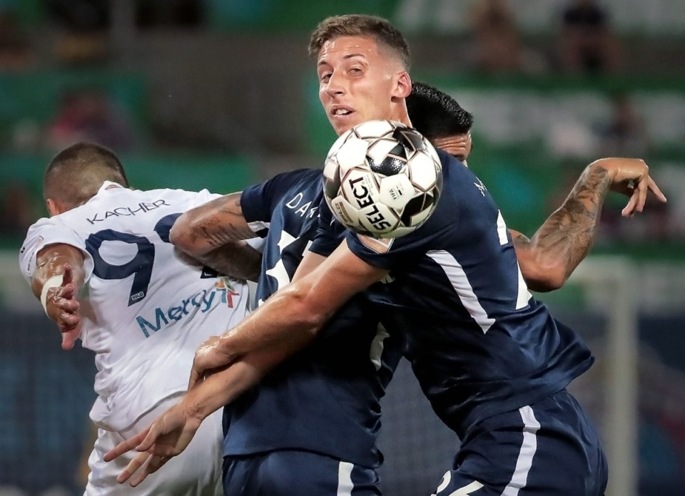 <strong>Memphis defender Josh Morton looks for the ball after a collision with the St. Louis FC squad's Masta Kacher (left) during 901FC's 1-0 win over St. Louis at AutoZone Park on Sept. 21, 2019.</strong> (Jim Weber/Daily Memphian)