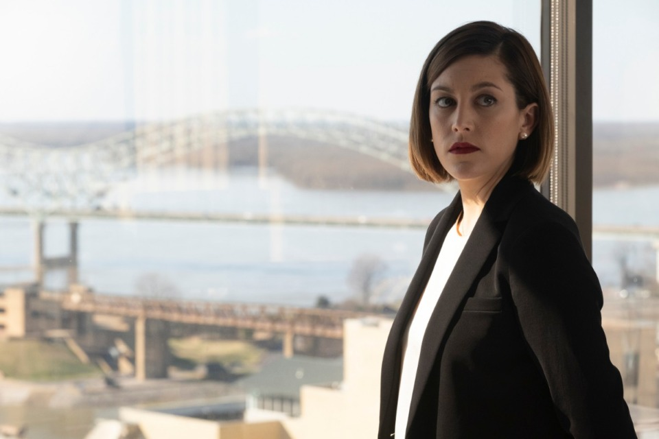 """<strong>Caitlin McGee is Sydney Strait, whose office window frames the Hernando de Soto Bridge in """"Bluff City Law.""""</strong> (Jake Giles Netter/NBC)"""
