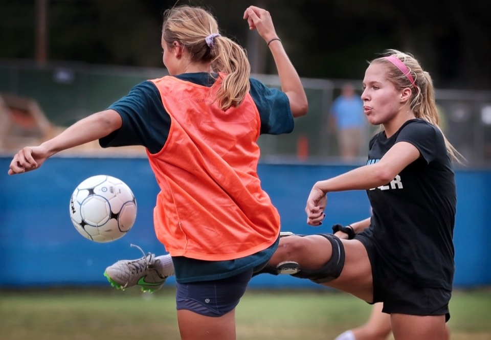 <strong>Katie Krahn (right) practices with the St. Mary's soccer team on Sept. 19, 2019. Krahn has been battling injury for two years to get back on the soccer field with her team. After three surgeries on a torn ACL the St. Mary's player has decided to risk re-injury to be able to play her senior year.</strong> (Jim Weber/Daily Memphian)