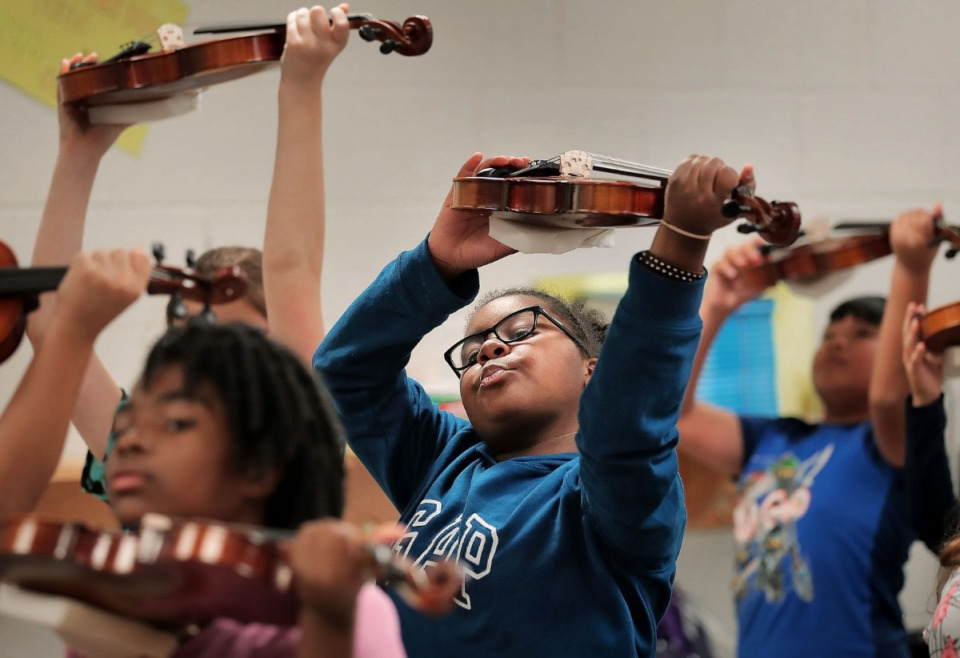 <strong>Fifth-grader Kennedy Evans follows instructions on how to properly hold the violin during a strings class at Bon Lin Elementary on Sept. 11, 2019. The Bartlett Community School District has added strings to its music program at two elementary schools including Bon Lin.</strong> (Jim Weber/Daily Memphian)