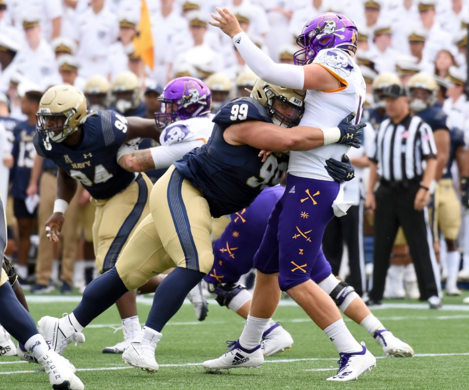 <strong>Navy's Jackson Pittman hits East Carolina quarterback Holton Ahlers in the first half of an NCAA college football game Saturday, Sept. 14, in Annapolis, Md.</strong> (Paul W. Gillespie/Associated Press)