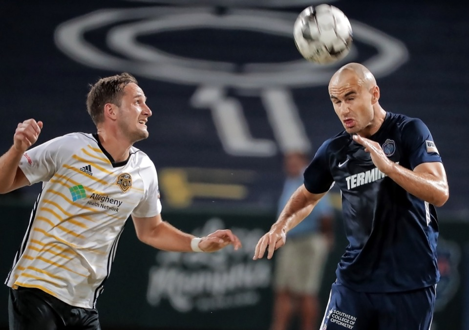 <strong>Memphis defender Liam Doyle (right) beat the Riverhounds' Christian Volesky (left) to a header during 901 FC's 0-1 loss.</strong> (Jim Weber/Daily Memphian)