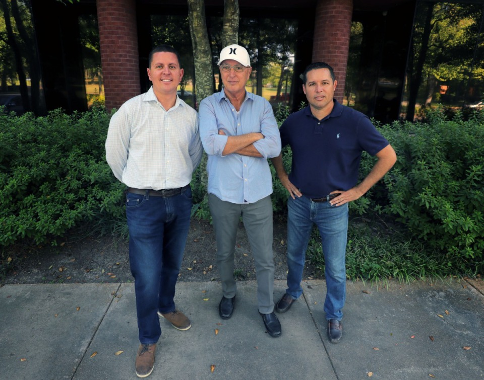 <strong>Brett Clothier, (from left), Kent Clothier Sr., and Chris Clothier stand in front of their newly-purchased two-story building at 1900 Exeter Sept. 13, 2019.</strong> (Patrick Lantrip/Daily Memphian)