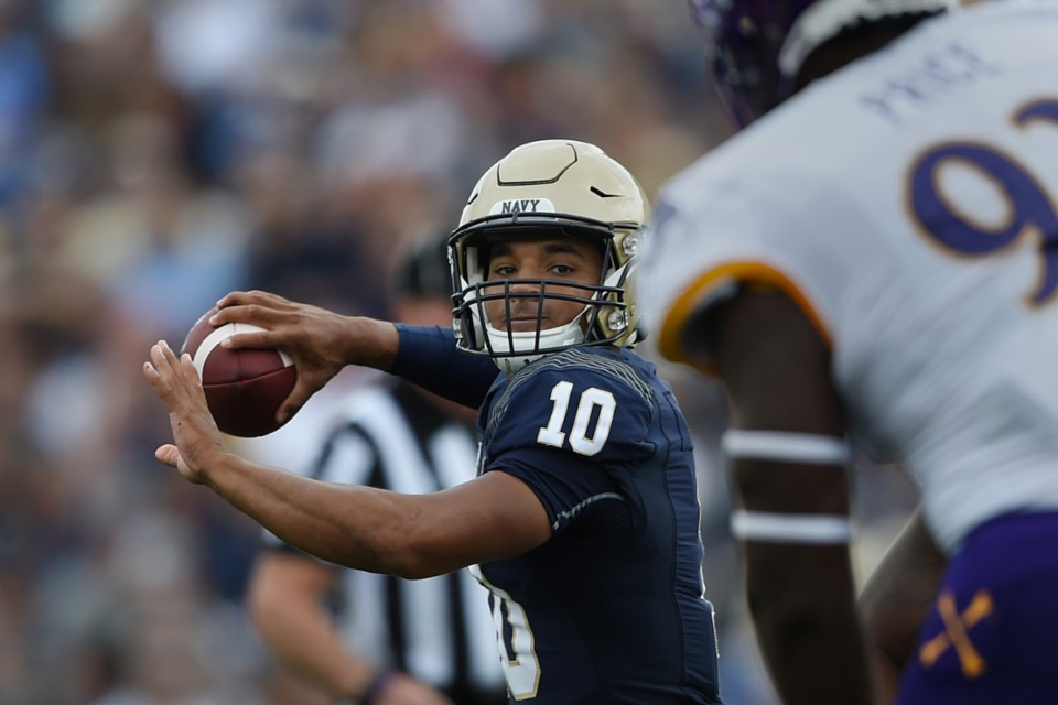 <strong>Navy quarterback Malcolm Perry (throwing a pass against East Carolina earlier this season) has moved back to calling signals in the Midshipmen triple option offense.</strong> (Gail Burton/AP)