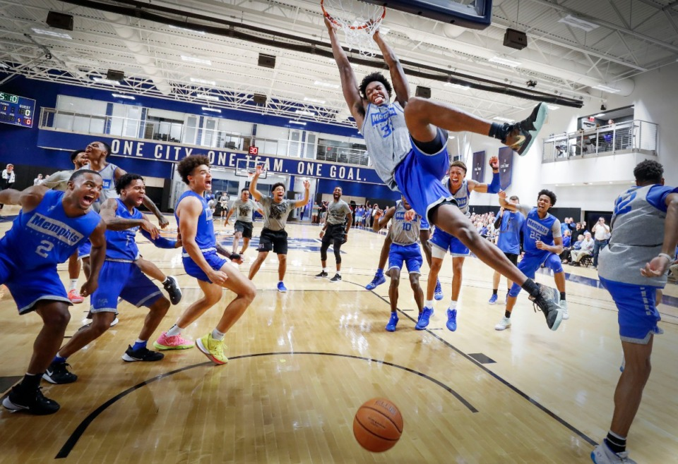 <strong>University of Memphis center James Wiseman (middle) dunks as his teammates celebrate during an open practice in front of the Rebounders Club at Laurie-Walton Family Basketball Center Tuesday, Sept. 24, 2019.</strong> (Mark Weber/Daily Memphian)