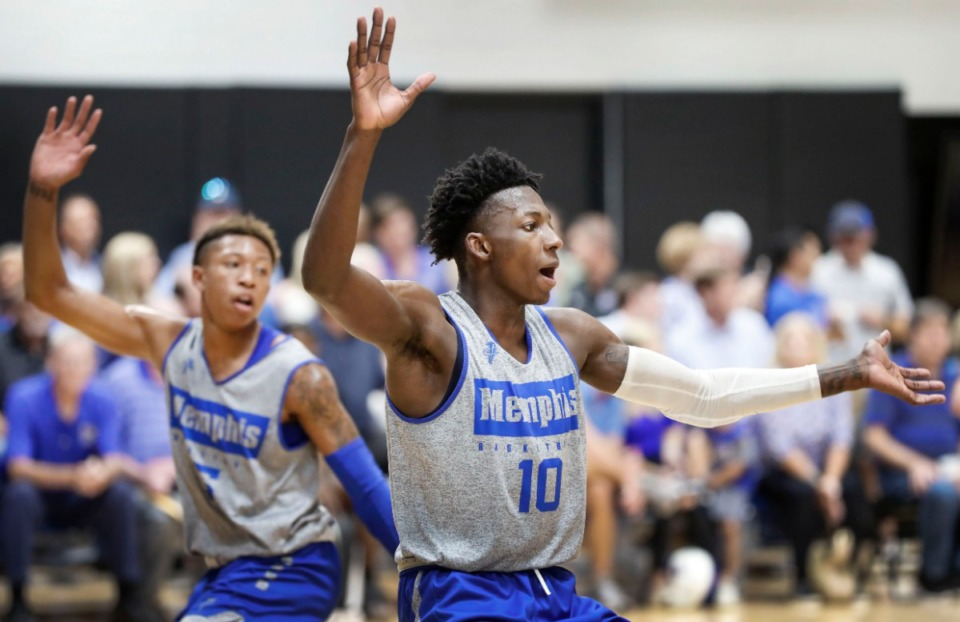 <strong>University of Memphis teammates Damion Baugh (right) and Boogie Ellis (left) run through defensive drills during an open practice in front of the Rebounders Club at Laurie-Walton Family Basketball Center Tuesday, Sept. 24, 2019.</strong> (Mark Weber/Daily Memphian)