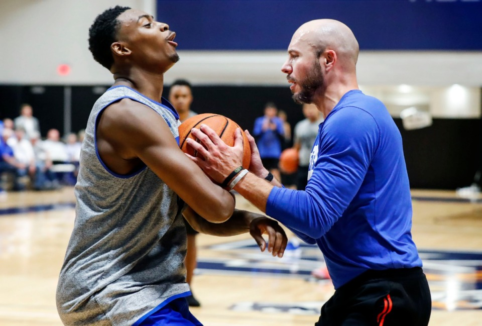 <strong>University of Memphis forward D.J. Jeffries (left) takes a charging foul while running through drills with assistant coach Cody Toppert (right) during an open practice in front of the Rebounders Club at Laurie-Walton Family Basketball Center Tuesday, Sept. 24, 2019.</strong> (Mark Weber/Daily Memphian)