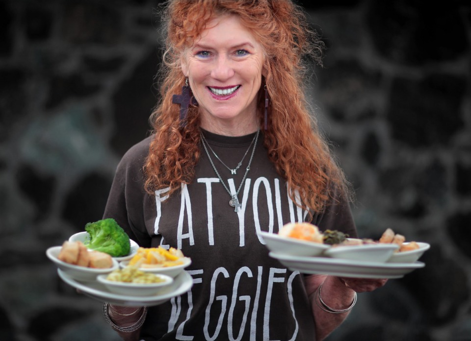 <strong>Veggies are a staple at Patrick&rsquo;s in East Memphis, where server Jo Delahunty-Chetter sports a T-shirt to that effect. Veggie fans can partake of Southern classics like turnip greens, squash and onions, broccoli, lima beans and fried eggplant</strong>. (Jim Weber/Daily Memphian)