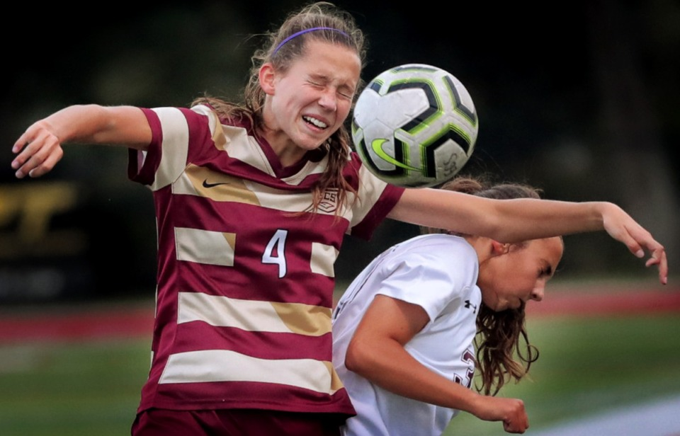 <strong>Delaney Stookey (4) from ECS bumps Collierville's Morgan Smrt out to get first touch Sept. 26.</strong> (Jim Weber/Daily Memphian)