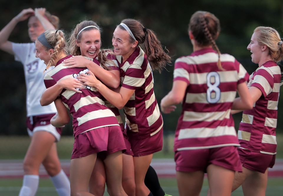 <strong>Annie Todd (left) from ECS celebrates with teammates after a goal in the first half during Collierville's 2-1 win over ECS at Legends Field Sept. 26.</strong> (Jim Weber/Daily Memphian)