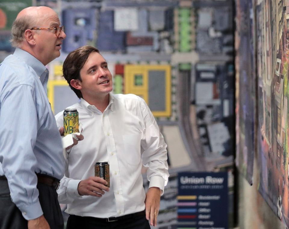 <strong>Stuart Maxwell (right) and Ben Adams discuss the newly unveiled plans for Union Row Thursday, Sept. 26 in an old warehouse that will be ground-zero for the extensive project in Downtown Memphis.</strong> (Patrick Lantrip/Daily Memphian)