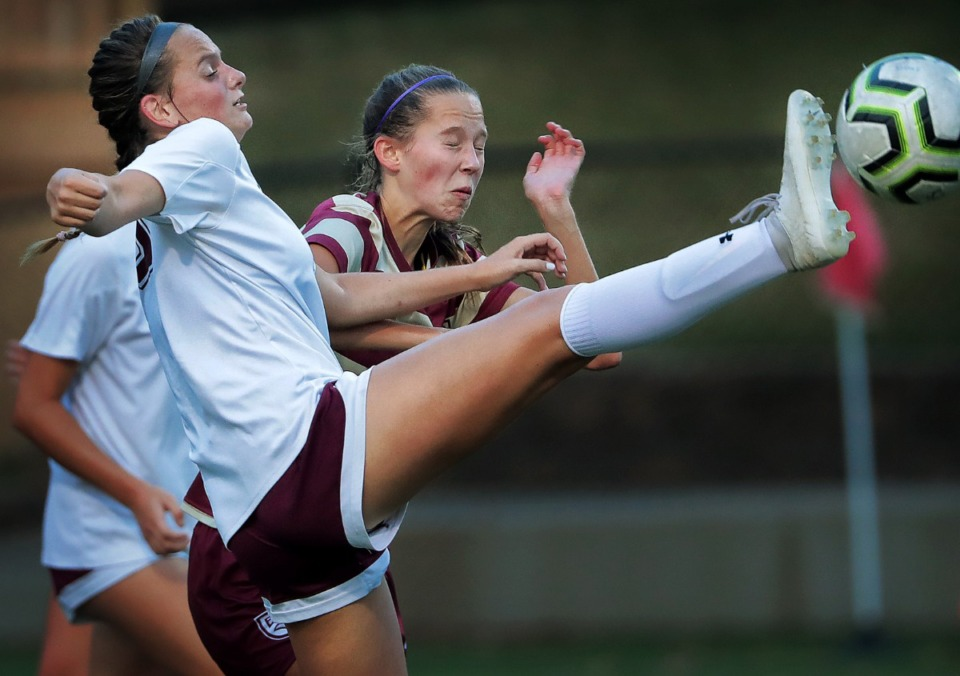 <strong>Collierville's Zoe Cultra (left) gets a foot on the ball under pressure by Delaney Stookey from ECS during Collierville's girls soccer game against ECS at Legends Field Sept. 26.</strong> (Jim Weber/Daily Memphian)