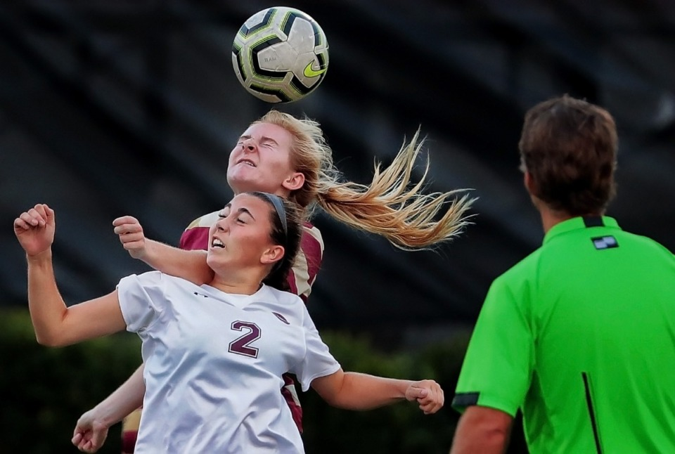 <strong>Leslie Coleman from ECS beats out Collierville's Reese Stimpson (2) on a header Sept. 26.</strong> (Jim Weber/Daily Memphian)