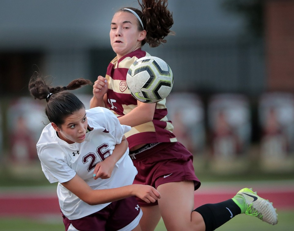 <strong>Collierville's Sophia Weis (26) collides with Emma Hudson from ECS during Collierville's girls soccer game against ECS Sept. 26.</strong> (Jim Weber/Daily Memphian)