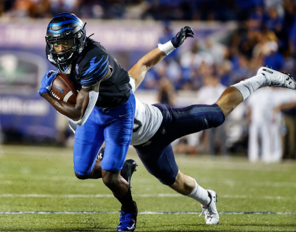 <strong>Memphis receiver Damonte Coxie (left) grabs a touchdown catch in front of Navy defender Kevin Brennan (right) in the U of M's 35-23 victory at Liberty Bowl Memorial Stadium Sept. 26.</strong> (Mark Weber/Daily Memphian)