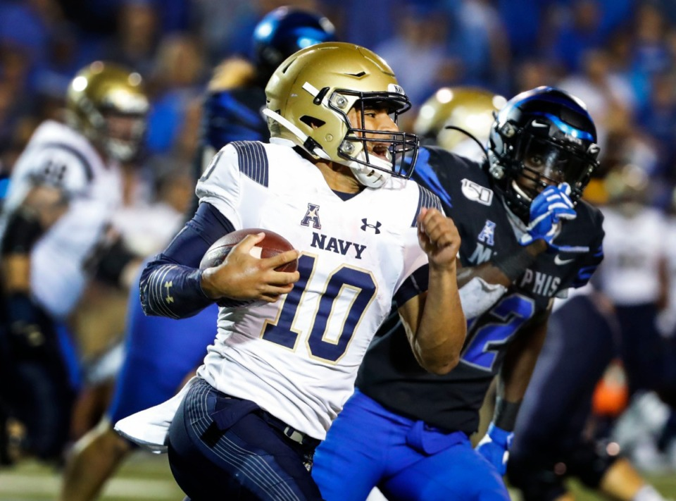 <strong>Navy quarterback Malcolm Perry (with ball) looks for a lane against Memphis.</strong> (Mark Weber/Daily Memphian)