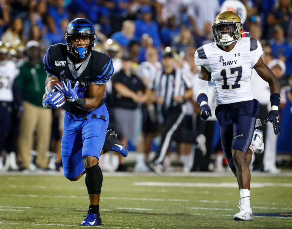 <strong>Memphis receiver Antonio Gibson (left) hauls in a touchdown catch in front of Navy defender Colby Jacques (right) Thursday night.</strong> (Mark Weber/Daily Memphian)