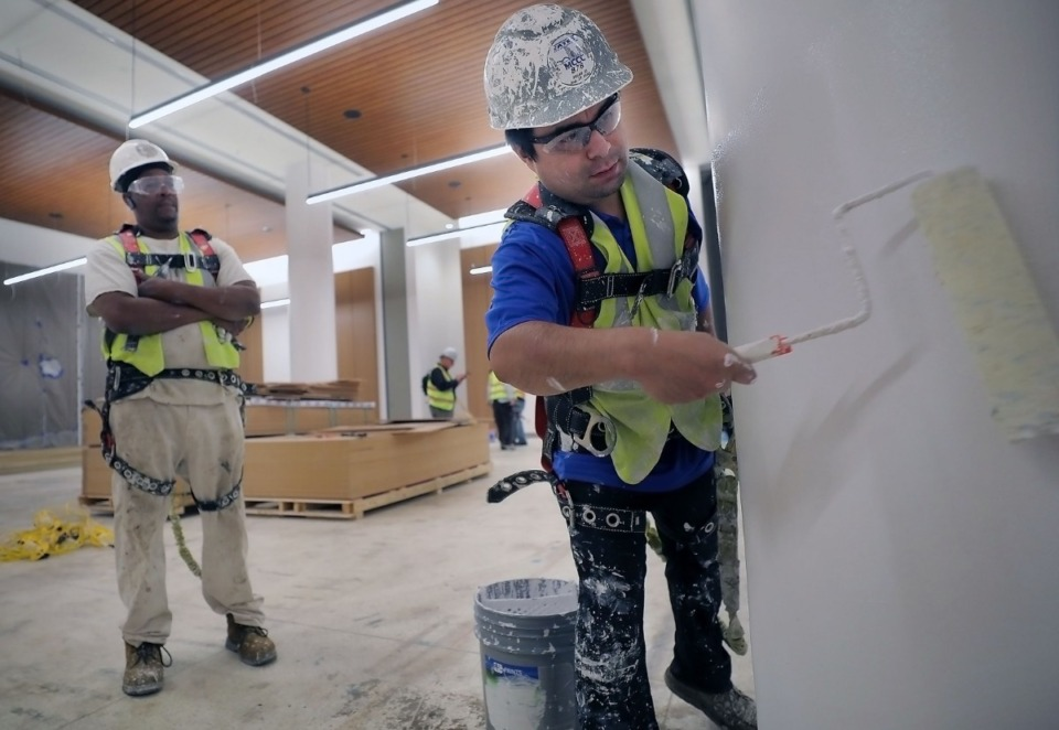 <strong>Ulises Luna (right) and Anthony Sharp paint a column at the Memphis Cook Convention Center Friday, Sept. 27, as it undergoes a $200 million upgrade.</strong> (Patrick Lantrip/Daily Memphian)