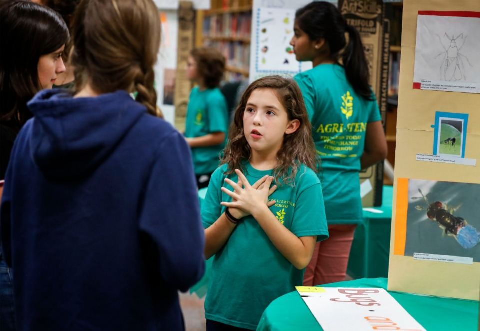 <strong>West Collierville Middle School sixth-grader Ana Cruz discusses her board on careers in entomology during an Agri-STEM Expo at the school on Sept. 20.&nbsp;&ldquo;Since I was a little kid, I've wanted to be a teacher,&rdquo; Ana said. &ldquo;Then I went to the agriculture camp, and I realized I really want to do something in the agriculture field.&rdquo;</strong>&nbsp;(Mark Weber/Daily Memphian)