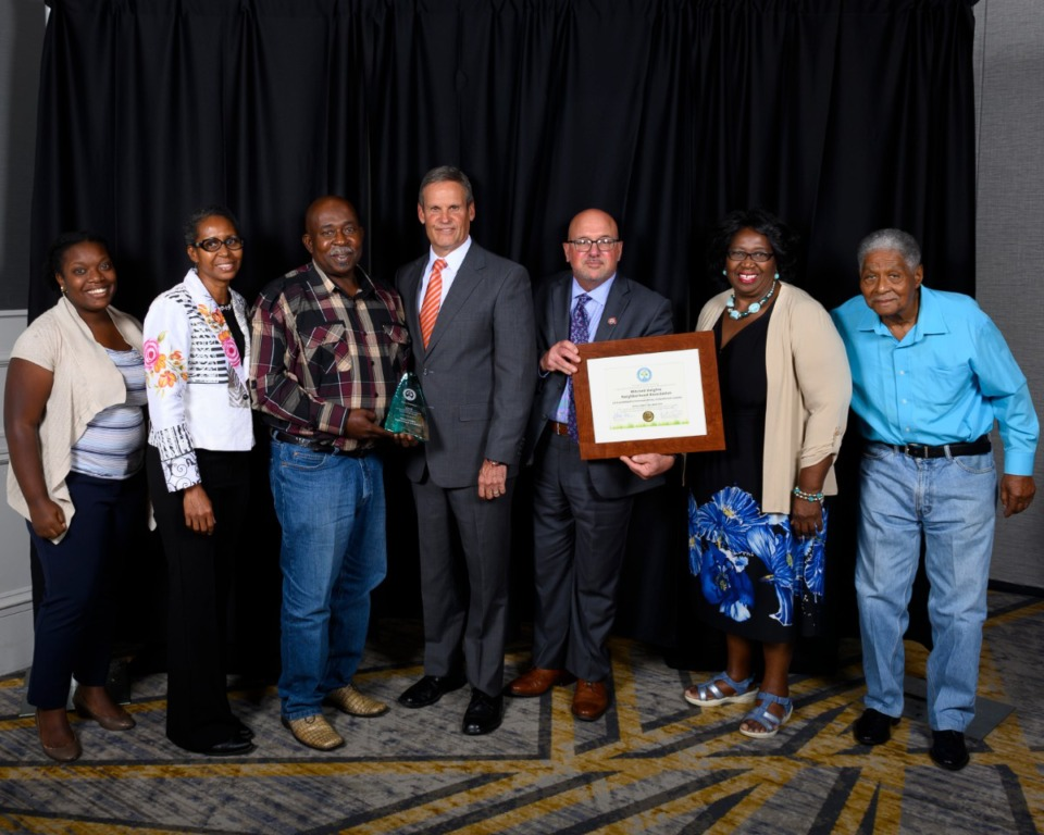 <strong>Members of the Mitchell Heights Neighborhood Association were presented with the 2019 Tennessee Governor's Award for Environmental Stewardship by Gov. Bill Lee (center) in Nashville on Aug. 1.</strong> (Photo courtesy of TN.gov)