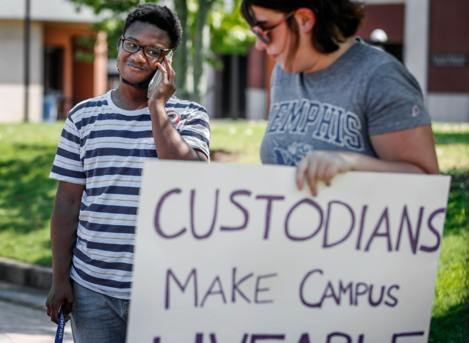<strong>University of Memphis student Tre Black (left), chairman of The Memphis Young Democratic Socialists, led a protest on campus Friday, Sept. 27. The group is urging that all campus workers earn a $15 per hour wage.</strong> (Mark Weber/Daily Memphian)