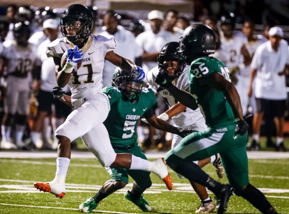 <strong>Whitehaven running back Cameron Sneed (with ball) scrambles past the Cordova defense on his way to a touchdown Friday, Sept. 27.</strong> (Mark Weber/Daily Memphian)