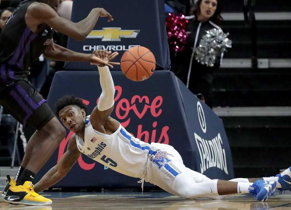 <strong>University of Memphis guard Kareem Brewton Jr. (5) tries to get control of a loose ball during the Tigers' game against LeMoyne-Owen at FedExForum on Oct. 25, 2018.</strong> (Jim Weber/Daily Memphian