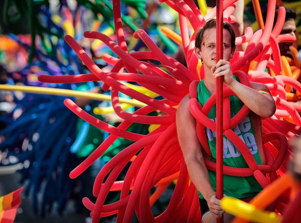 <strong>A balloon-clad Victor Hard marches with other folks from The Pumping Station bar during the 16th annual Memphis Pride Parade along Beale Street on Saturday, Sept. 28. The bar appears in the parade annually with its Balloon Brigade display.&nbsp;</strong> (Jim Weber/Daily Memphian)