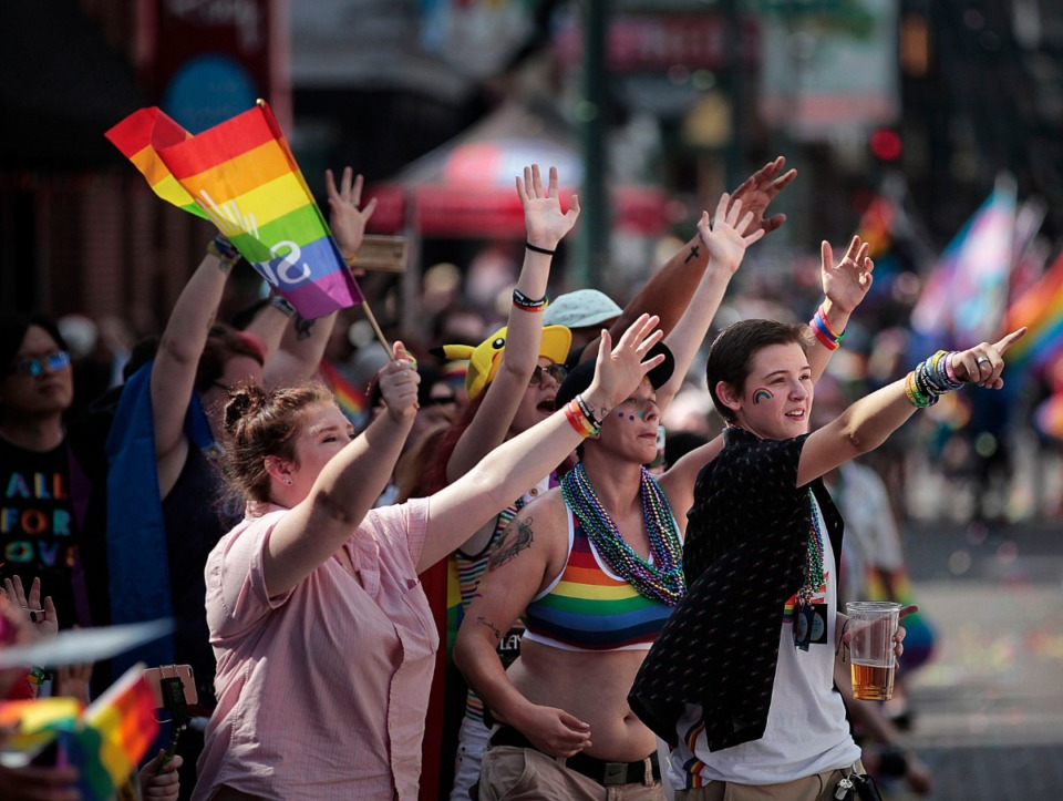 <strong>LGBTQ supporters cheer on their favorite groups and floats during the 16th annual Memphis Pride Parade along Beale Street on Saturday, Sept. 28.</strong> (Jim Weber/Daily Memphian)