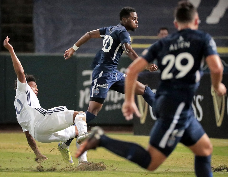 <strong>Memphis midfielder Marcus Epps (30) scores against Bethlehem Steel under pressure by Nathan Harriel (left) during 901 FC's 5-0 win.</strong> (Jim Weber/Daily Memphian)