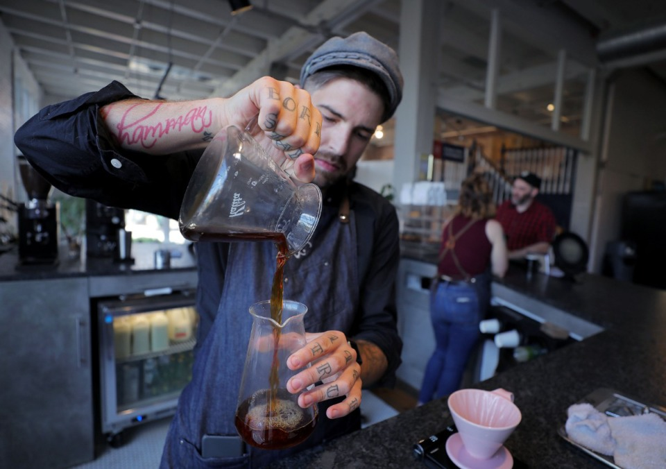 <strong>Benjamin Fulfer prepares a pour-over coffee at Dr. Bean's Coffee and Tea Emporium inside Puck Food Hall at 409 S. Main Sept. 27.</strong> (Patrick Lantrip/Daily Memphian)