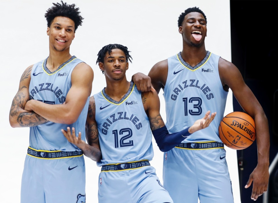 <strong>Teammates from (from left) Brandon Clarke, Ja Morant and Jaren Jackson Jr. vamp for photos during the Memphis Grizzlies Media Day Monday,</strong> <strong>Sept. 30.</strong> (Mark Weber/Daily Memphian)