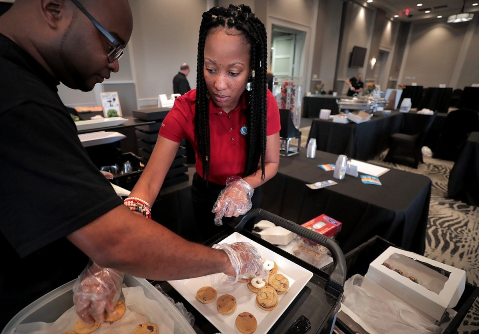 <strong>Christopher (left) and Cassandra Gray with Quintessential Sweets put out desserts for the 12th annual Bartlett a la Carte event at the Esplanade Banquet &amp; Conference Cente showcasing restaurants and flavors of Northeast Shelby County.</strong> (Jim Weber/Daily Memphian)
