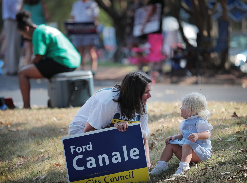 <strong>Sophie Canale tries to cheer up Rollins Canale, 2, while campaigning at Second Baptist on Walnut Grove Road during a day of ballot casting on Oct. 3, 2019. Memphians turned out to vote on a number of local elections on Oct. 3, 2019 including a sales tax increase, City Council races and a contentious mayoral race.</strong> (Jim Weber/Daily Memphian)&nbsp;