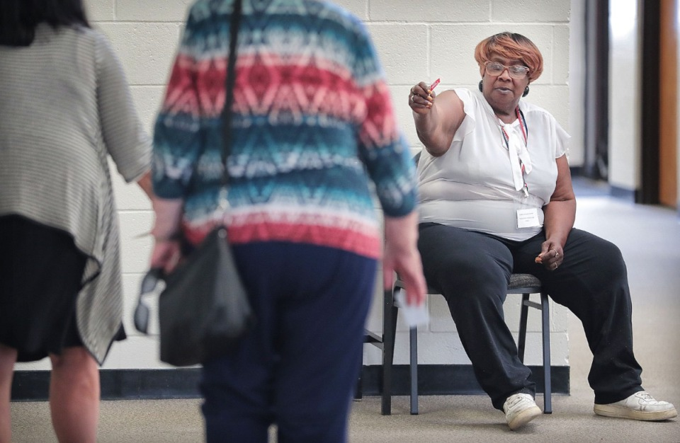 <strong>Diane Ellington passes out 'I voted' stickers during a day of ballot casting at Open Door Bible Church on Oct. 3, 2019. Memphians turned out to vote on a number of local elections on Oct. 3, 2019 including a sales tax increase, City Council races and a contentious mayoral race.</strong> (Jim Weber/Daily Memphian)