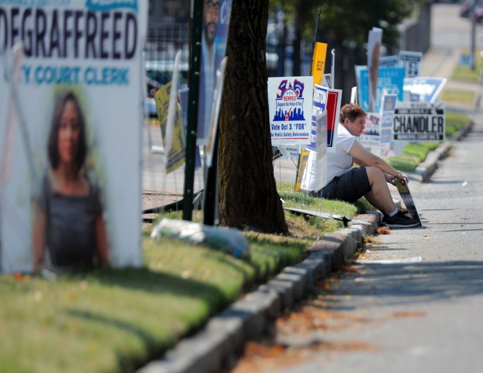 <strong>Katherine Turner braves the unseasonably extreme heat on an early October election day in Memphis to campaign for Memphis City Council hopeful John Marek outside of Mississippi Boulevard Christian Church on Oct. 3, 2019.</strong> (Patrick Lantrip/Daily Memphian)