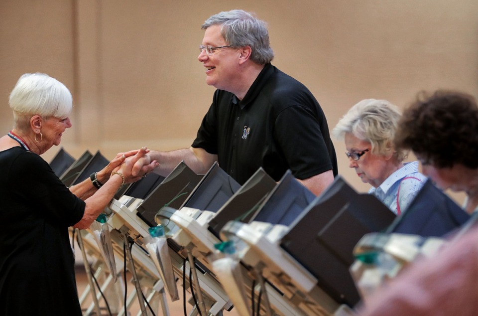 <strong>Memphis Mayor Jim Strickland talks briefly with poll worker Ann Huffman before casting his vote during a day of ballot casting at Second Baptist on Oct. 3, 2019. Memphians turned out to vote on a number of local elections on Oct. 3, 2019 including a sales tax increase, City Council races and a contentious mayoral race.</strong> (Jim Weber/Daily Memphian)&nbsp;