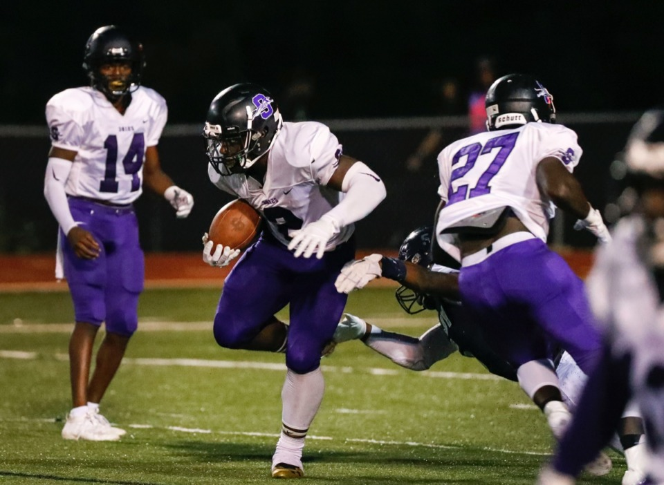 <strong>Southwind running back Romal Webb (with ball), seen here in the game against Kirby Sept. 20, put up some impressive numbers this week. He's second in rushing yards per game with&nbsp;163.8, first in total rushing yards with 983 and second in all-purpose yards per game with 211.3.&nbsp;</strong>(Mark Weber/Daily Memphian)