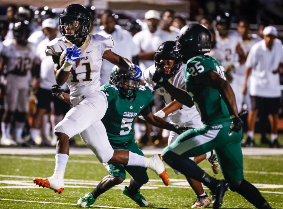 <strong>Whitehaven running back Cameron Sneed (with ball) and the Tigers beat Cordova 21-0 Sept. 27, and took this week's No. 1 spot again. Next up: White Station on Oct. 11.</strong> (Mark Weber/Daily Memphian)