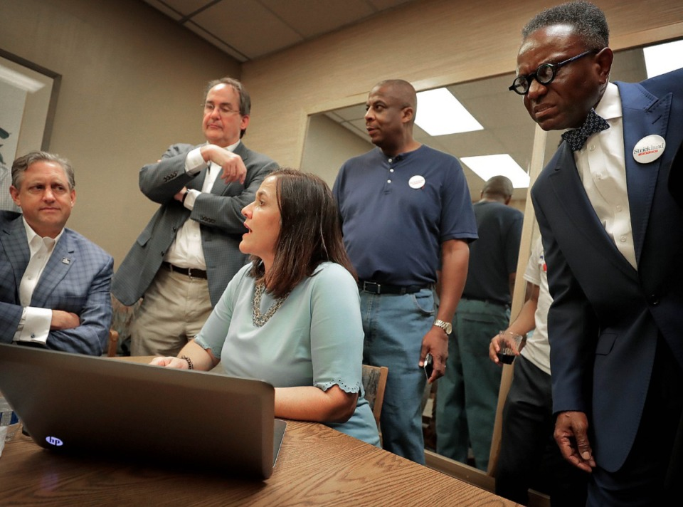 <strong>Melanie Strickland (center), wife of Memphis Mayor Jim Strickland, keeps an eye on the election results with members of Strickland's campaign team during an election night party at the Memphis Botanic Garden on Oct. 3, 2019.</strong> (Jim Weber/Daily Memphian)